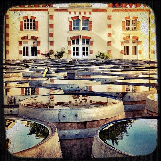 Empty wine barrels resting outside the Krug HQ in Reims from @wineprick