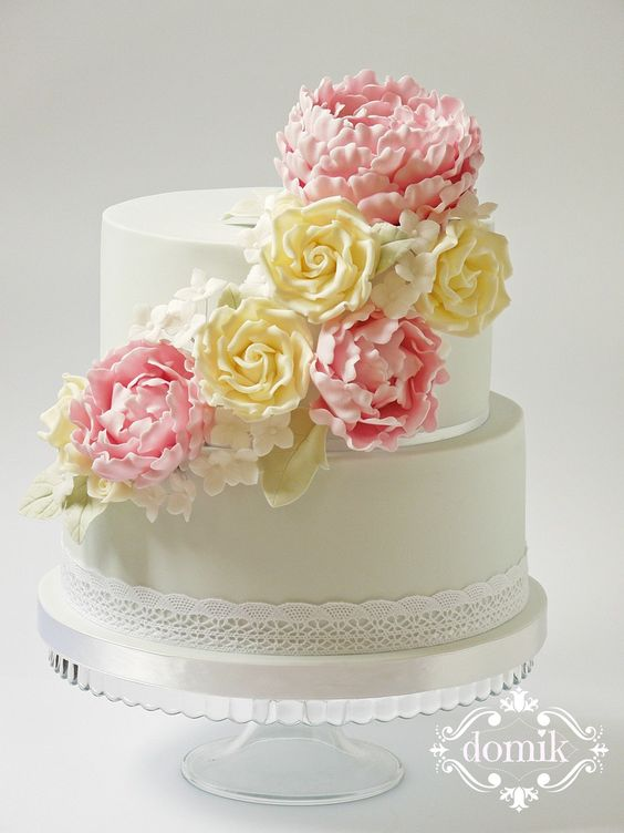 Wedding cake with peonies and roses