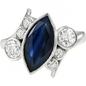 Marquise sapphire and round brilliant diamond ring