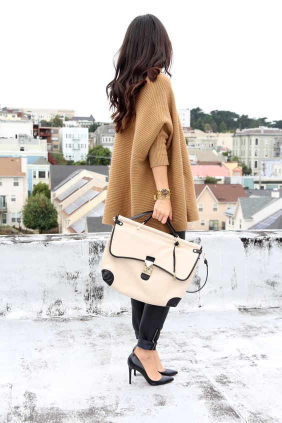 the key to the gorgeous oversize sweater is the bottom half needs to be fitted... notice fitted pants, sexy heel..awesome bag... if she had wide-legged flowy pants, ummm no...