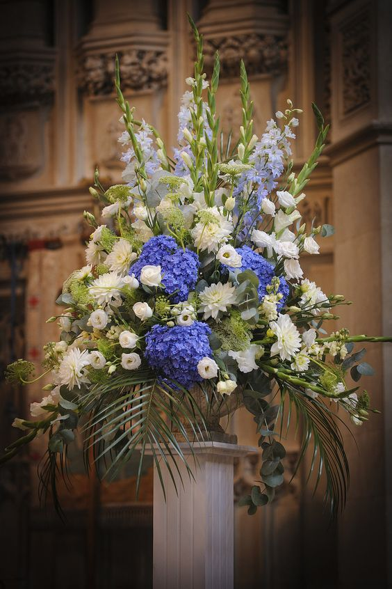 Periwinkle blue hydrangea and white church flower display