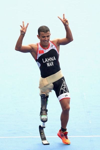 Mohamed Lahna of Morocco celebrates as he crosses the finish line to finish thrid the men's triathlon PT2 at Fort Copacabana during day 3 of the Rio 2016 Paralympic Games on September 10, 2016 in Rio de Janeiro, Brazil.