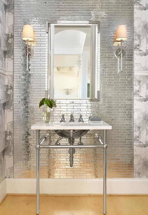 A Nickel And Lucite Vanity Mirror Hangs From A Wall Clad Horizontal Thin Mirrored Tiles Lit By Ca Mirror Tiles Bathroom Bold Bathroom Tile Antique Mirror Tiles