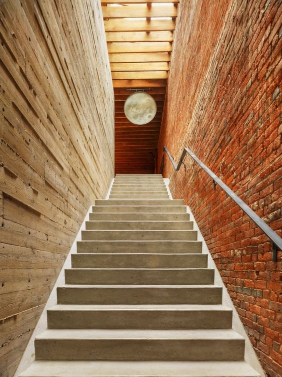 combination of wooden and brick wall with stairs and railings for heritage building by omer abel architect omer arbel office click