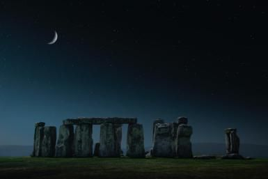 New Moon Magic: How to Start Your Own Monthly Ritual: Crescent moon over Stonehenge monument, Wiltshire, United Kingdom Credit: Chris Clor: