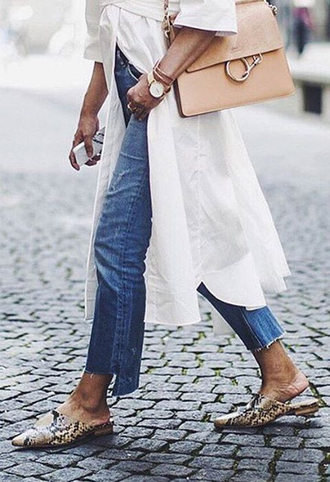 Deconstructed jeans aren't just for 90s queens, you know. Slip on some matchy neutral accessories – mules for the win – with a crisp white shirt dress for seriously sleek Scandi feels