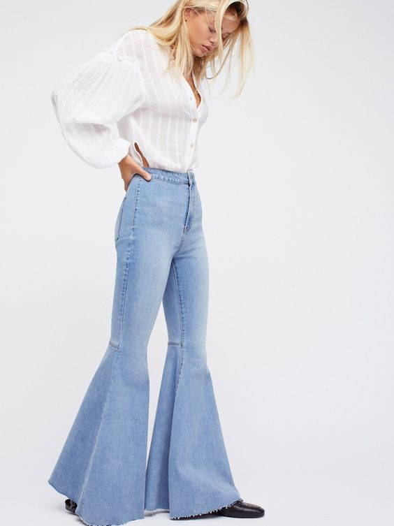 Just Float On Flare | In a clean silhouette with a flat front these high-rise jeans feature a flared leg with a raw hem.    * Back seam detailing on the knee * Super soft and super stretch fabric  * Back pockets * Button closure and zip fly