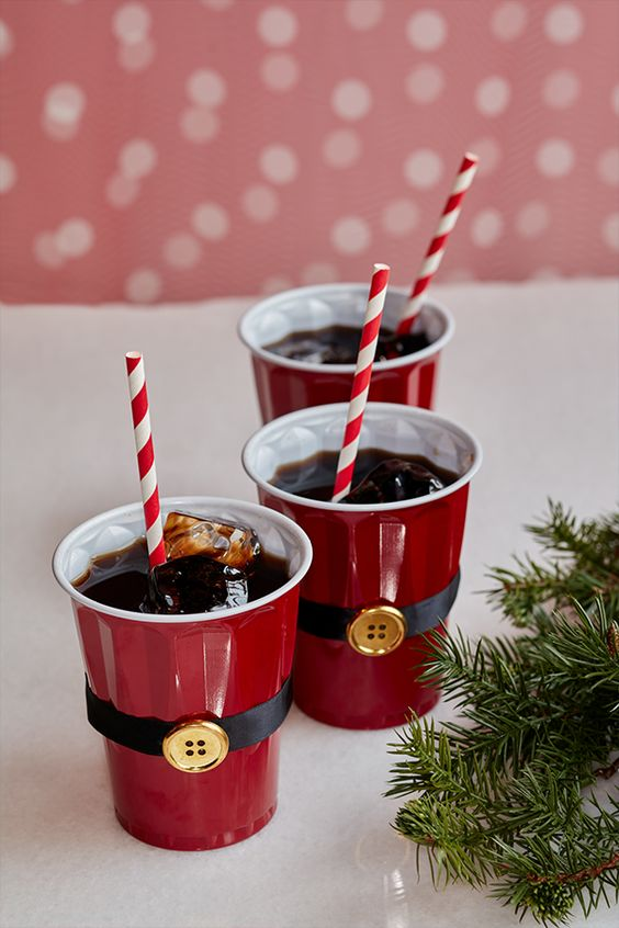 Bored with using plain red cups at your holiday party? Use black ribbon and a gold button to turn your cups into Santa cups