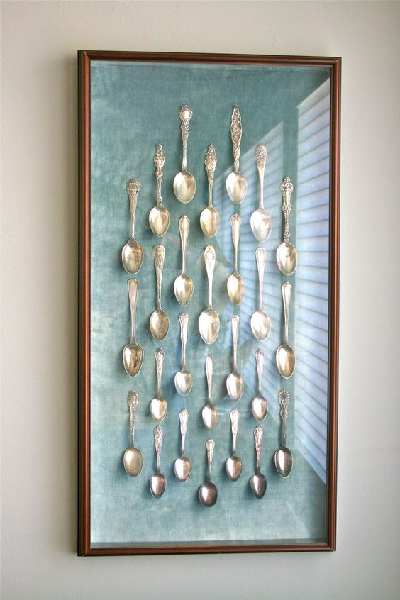 Antique Silver Spoon Collection Displayed On Antique Blue