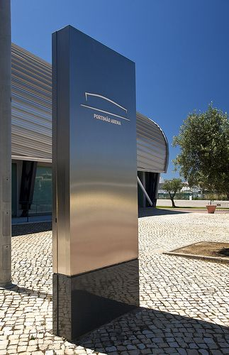 A beautiful sleek pylon sign very elegant and effective for Exterior signage design