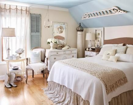 Vintage dreams Vintage finds and a mostly white palette, accented by a soft grey-blue ceiling, give this bedroom a dreamy feel.