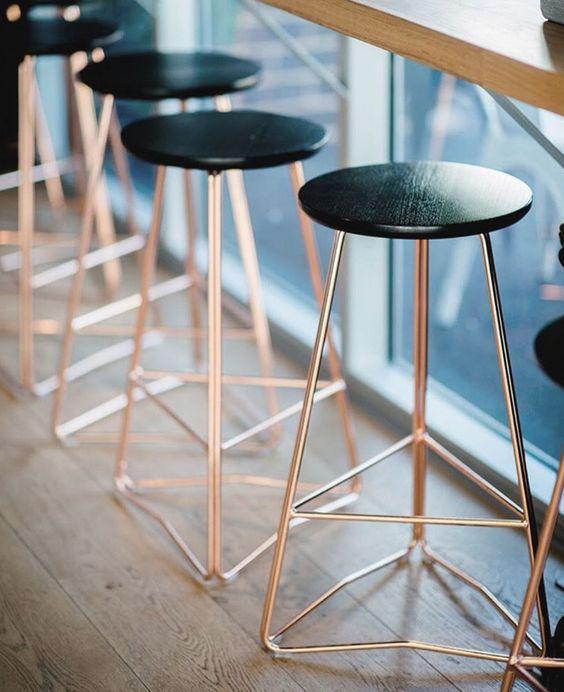 Rose Gold and Black bar stools.: