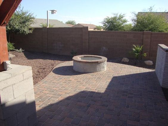 Wood Burning Fire Pit With A Paver Patio Capped In Pavers To Match Stucco Sides Great Small
