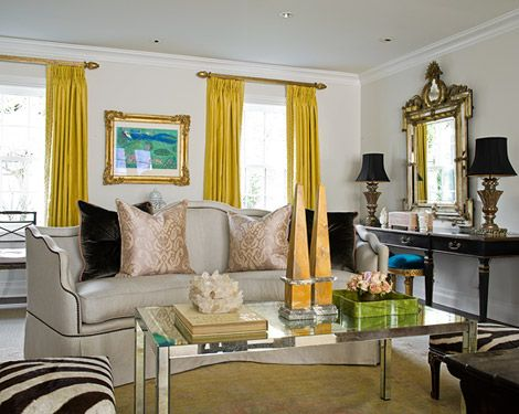 Living Room With Bright Accents Curry Yellow Silk Draperies And Peacock Blue Velvet Stools Add