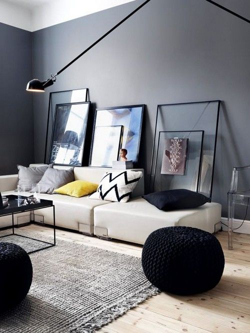 I do like this space a lot, but I'm wondering why the frames are on the wall. Lovely gray paint color though
