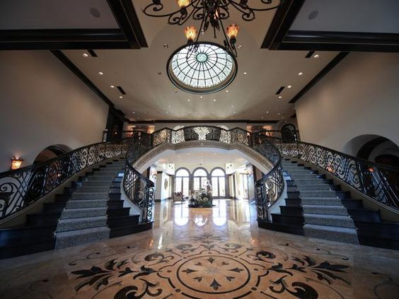 Million Dollar Rooms: Over the top foyer with dual staircase.