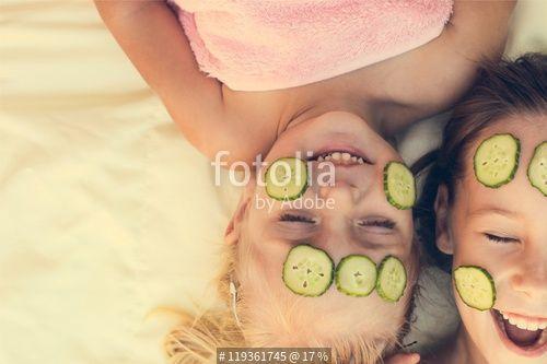 """Beautiful girl with facial mask of cucumber. Toned image "" Stockfotos und…"