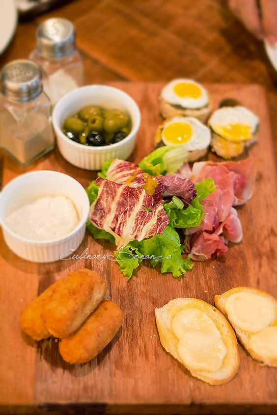 Sharing Board: Prosciutto, tapenade toasts, chicken croquettes ...