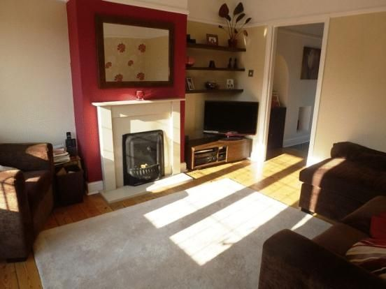Living room with neutral decor and burnt red chimney - Burnt orange feature wall living room ...