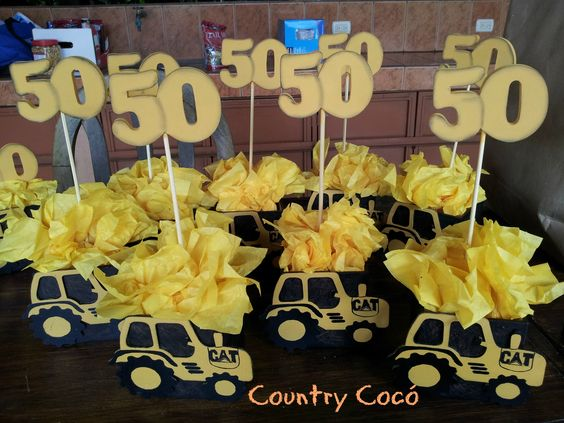 Centros de mesa para 50 a os estilo caterpillar country for Decoracion 80 anos hombre
