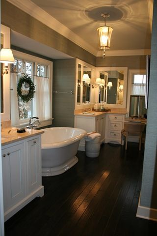 dark hardwood floors + bath + fixtures... so beautiful and cozy!
