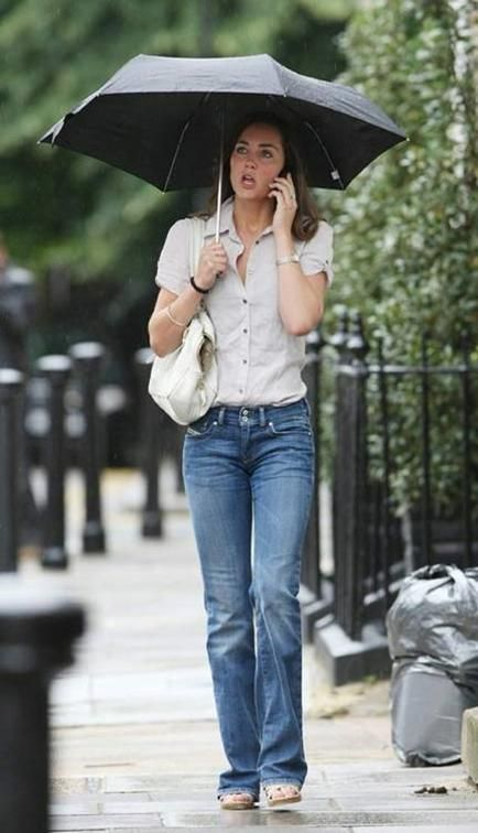 Kate Middleton casual street style from before her marriage jeans and an umbrella