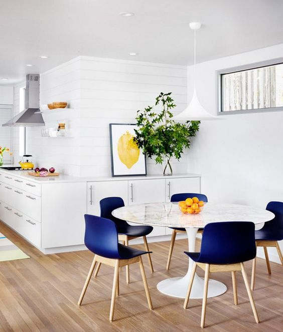 Love the blue accent chairs!