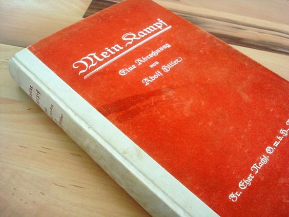 """Mein Kampf (My Struggle) by Adolf Hitler was first published in two parts in 1925 and 1926 after Hitler was imprisoned for leading Nazi Brown Shirts in """"Beer Hall Putsch"""" that tried to overthrow the Bavarian government. Here Hitler explained his racist, anti-Semitic vision for Germany, laying out a Nazi program pointing directly to World War II and the Holocaust. He envisioned the mass murder of Jews, and a war against France to precede a war against Russia to carve out """"lebensraum"""" (""""living…"""