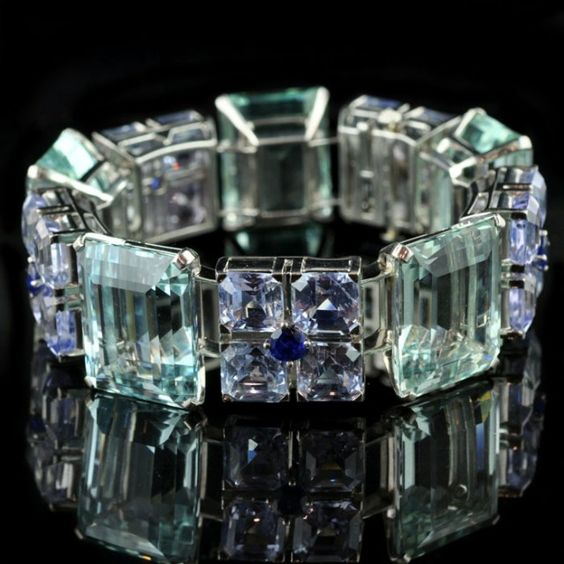 Oscar Heyman bracelet. Five large step-cut aquamarines flanked by 20 square and five round-cut sapphires set in platinum. 1935
