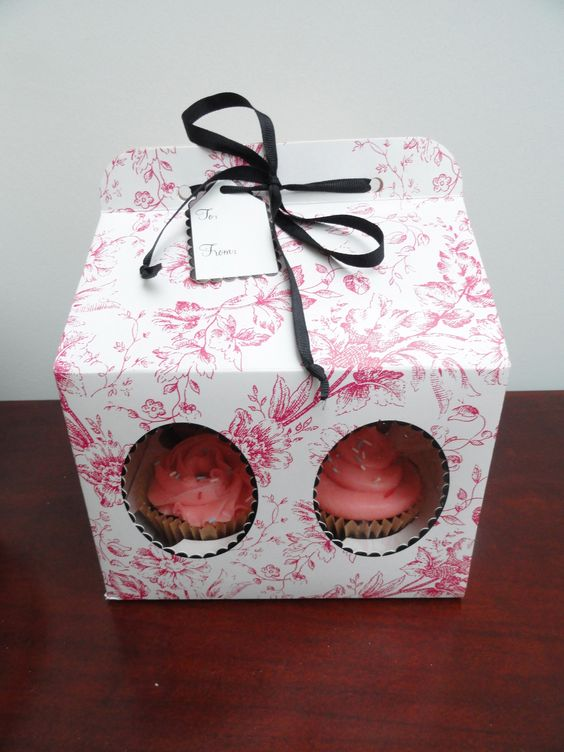 Homemade chocolate cupcakes with pink buttercream in a lovely pink box ...