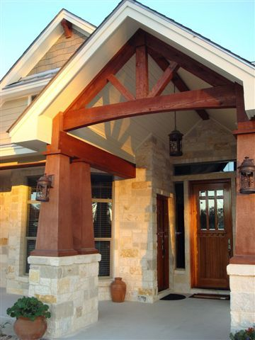 Tapered cedar columns and exposed truss architecture for Open beam front porch