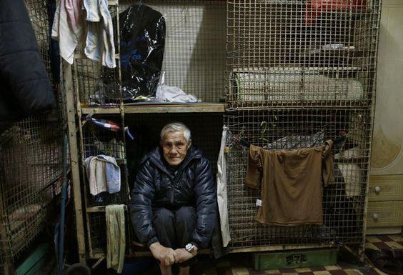 Cage homes of Hong Kong highlight poverty.: