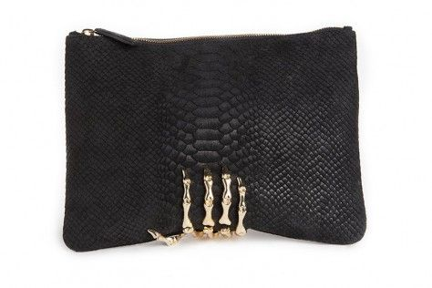 Large size measures approximately 11.3? x 8.5? . Features a metal skeleton hand on luxurious black python embossed suede. Lined with black material. Credit card holder inside.