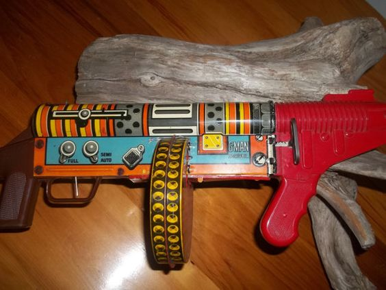 Share Vintage toy wooden machine gun