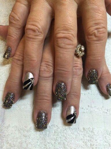 Black glitter, rhinestone and stripes on silver
