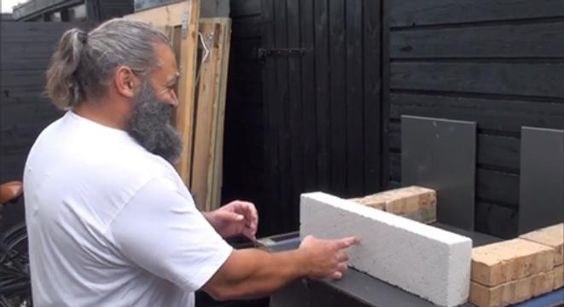 Just Two Minutes Of A Guy One-Inch Punching A Bunch Of Concrete Bricks In Half