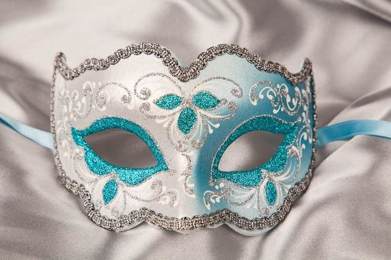 Beautiful... only one change I would make to it. The side with the blue face would have silver around the eye and have the flowers on top transition from blue to silver