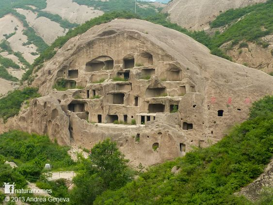 The caves homes of Guyaju (Guyaju meaning, ancient cliff dwelling) are about 90km northwest of Beijing, China. They were occupied during China's Tang Dynasty (AD 618-907) by the Xiyi people. With over 100 homes carved in to the hillside, Guyaju is an extraordinary place to explore. The homes, some with stylish pillars of stone, are arranged in two village clusters supplied with fresh water from a natural spring. More at www.naturalhomes.org