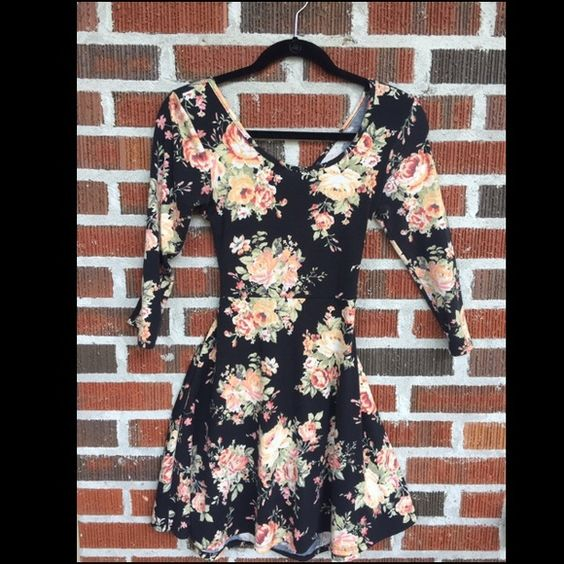 Black And Pink Floral Crisscross Dress Bought this a few months ago to wear to a wedding, only worn once. Tag says medium but I'm a small and it fits me. The material is very stretchy and of good quality. It has a mostly open back with crisscross pieces. Pine Dresses Backless