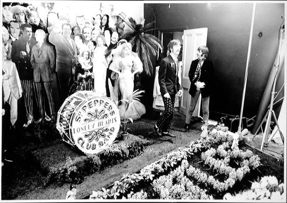 48 Unexpected Views Of Famous Historic Moments: The Beatle during their shoot for Sgt. Pepper's Lonely Club Band. (1967)