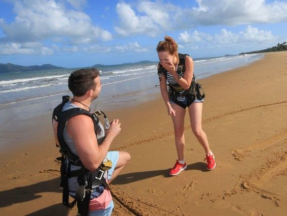 Now this is exciting. He asked her to marry him while skydiving on the beach!