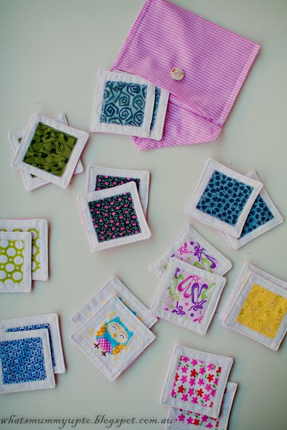 "Fabric scrap matching game - Do it the fastest way, zig-zag applique all the ""matches"" to the solid before cutting, then zig-zag around them onto the background in a grid, leaving space between for more cutting. Cut with pinking shears.:"