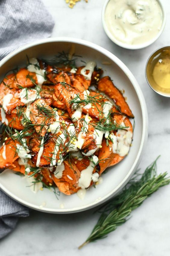 Honey-Roasted Sweet Potato Wedges with Dill - These delicious oven roasted healthy sweet potatoes with honey are baked to perfection and top the charts for sweet potato recipes. Crispy and soft, a great substitute for fries, these wedges are great as a side or to add to a salad or power bowl. Great for Thanksgiving too! #beeinspired #hivenextdoor
