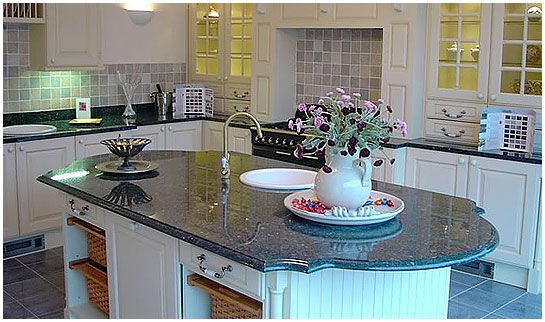 The granite tile here is unique in its shape and color. The deep blue with the angles and rounded accents make this something to behold, even without looking at the rest of the kitchen.