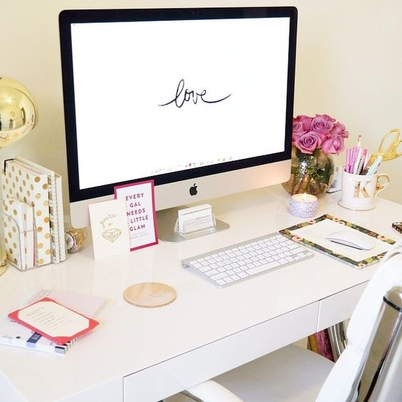 Click the photo to shop the look | Kristin Brophy of Fancy Things blog featuring a gold moroccan pouf, West Elm rug, Voluspa candles, West Elm desk, Kate Spade gold dots agenda, and Urban Outfitters gold desk lamp | Follow @liketkit on Pinterest for more outfit inspiration #liketkit: