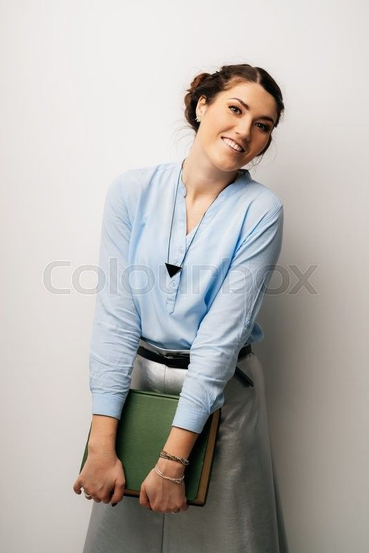 Stock image of 'Pretty brunette girl with book in hand'