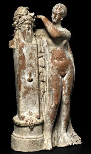 Aphrodite crowning a herm of Dionysos with an ivy wreath - 100BC from Myrina; now British Museum