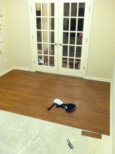 Diy vinyl plank flooring that looks like wood this for Super cheap flooring ideas