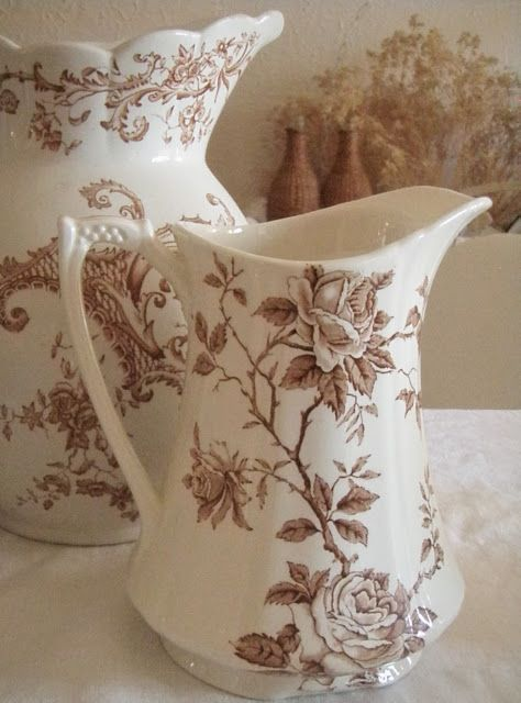 brown transferware pitchers...
