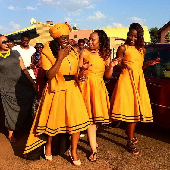 """Bride Gabisile Mathebula (left) and her bridal party dance on their way to present gifts to her new husband Thamsanqa Mbondane during their traditional wedding in Spruitview township, Johannesburg."" Pic by @jamesoatway"